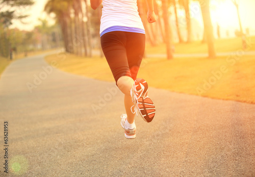young asian woman running at tropical park