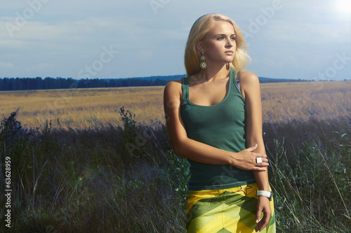Beautiful Woman on the field.nature background.Summer.Flowers