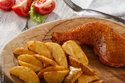 chicken leg with baked potatoes