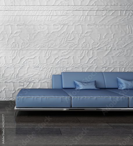 ..Blue couch against stone wall