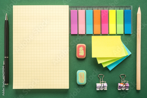 School office supplies on green background