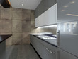 Modern kitchen interior with stone wall