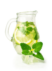 lemonade with ice and mint in a glass jug