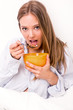 Young woman eating cereals