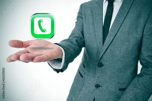 businessman with a telephone icon in his hand