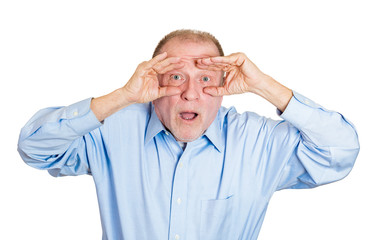 Binoculars surprised man. Portrait surprised senior guy