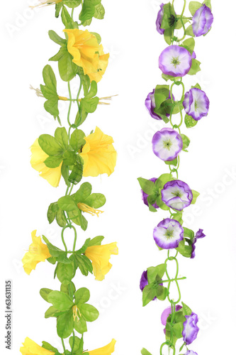 Purple and yellow artificial flowers.