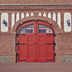 arched red door, central Europe