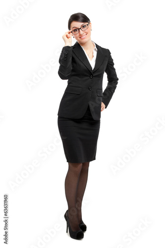Businesswoman holding her glasses full length