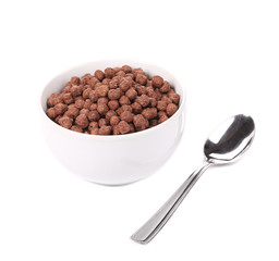 Chocolate cereals in porcelain white bowl.