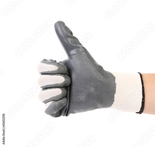 Hand with white fabric glove showing thumb up.