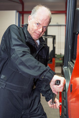 Chaning a tyre on a forklift