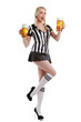 woman in soccer referee clothes and a beer