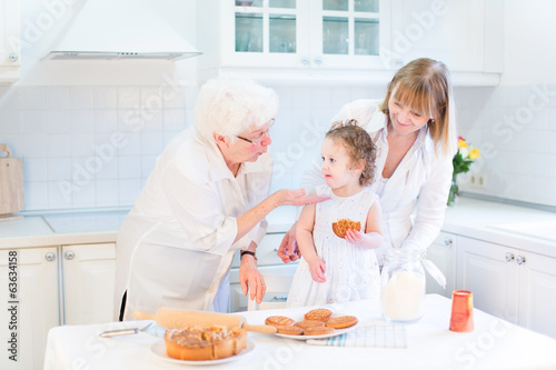 Grandmother having fung with her daughter and granddaughter