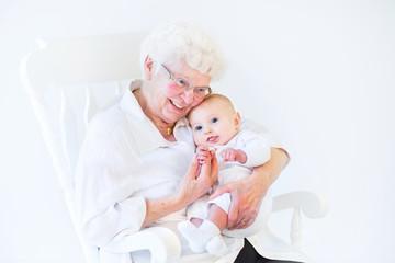 Beautiful grandmother singing to her newborn baby grandson