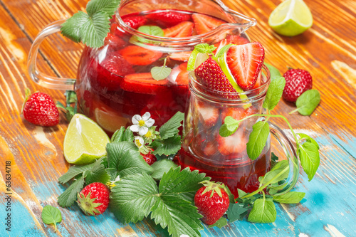 Strawberry juice with fresh strawberries and lime