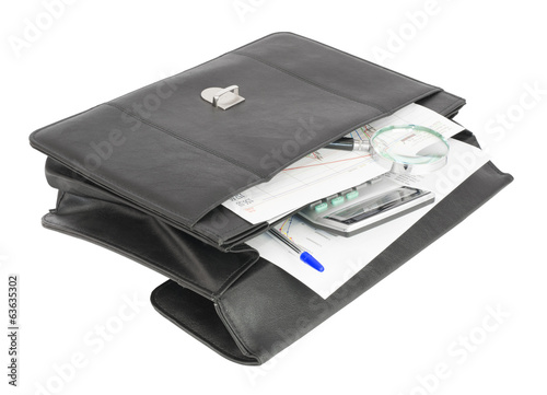 Open black briefcase and business objects