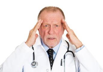 Headshot sad, overwhelmed, stressed elderly doctor