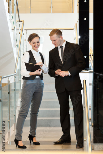 Woman showing statistics her colleague