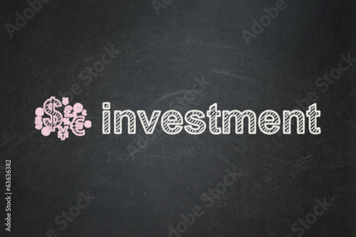 Business concept: Finance Symbol and Investment on chalkboard