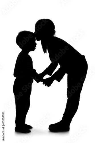 Silhouette of little girl and boy