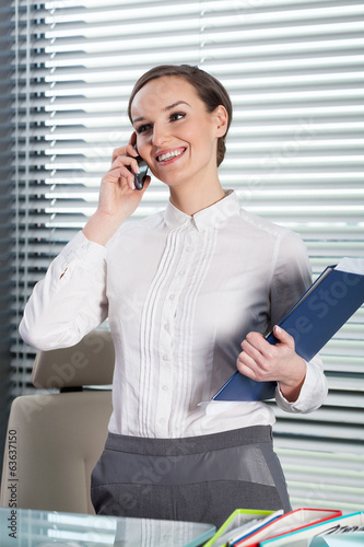 Beautiful secretary talking at the phone