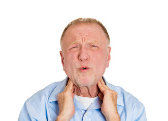 Elderly man having neck strain, pain and sprain