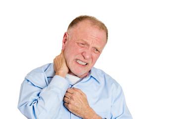 Elderly man having neck strain, pain and sprain