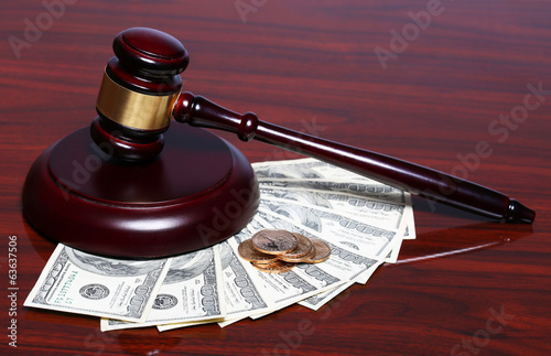 Judge Gavel and Money. Dollars Bills with Coins on the Table.