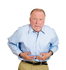 Old man having bad stomach ache
