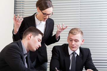 Irritated businesswoman at meeting