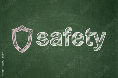 Security concept: Contoured Shield and Safety on chalkboard