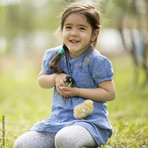 Cute little girl with the chickens