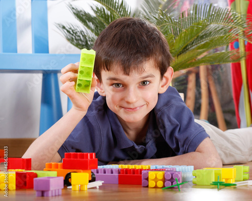Happy boy with colourful blocks