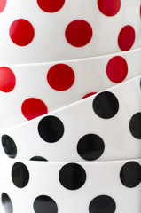 white dishes with black and red dots