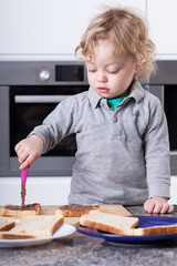 Child making sandwich