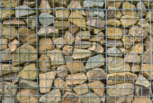 Small chunks of rock behind a mesh fence
