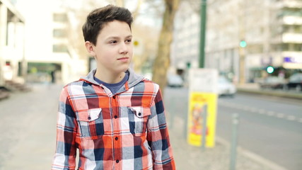 Happy young teenager walking in the city