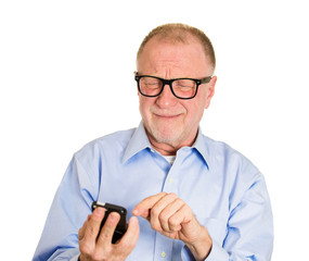 Bad text or email, senior man with glasses has difficulty to see
