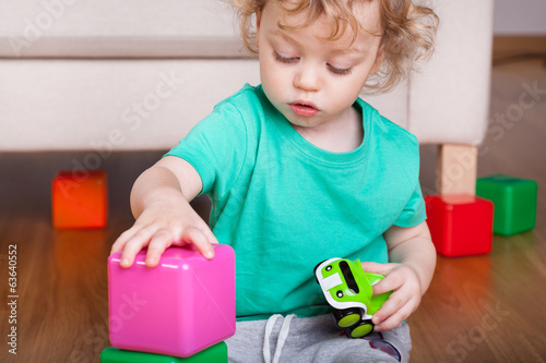 Boy playing with block toys