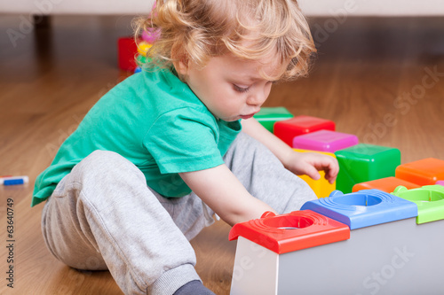 Toddler playing on the floor