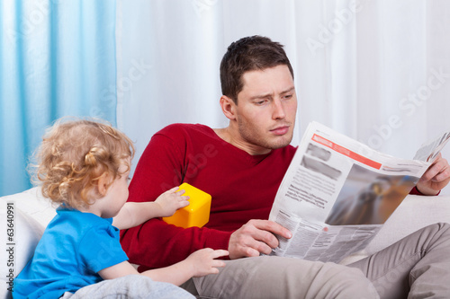 Bored child looking at father