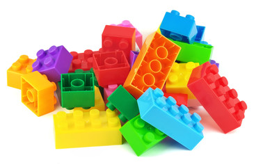 Toy colorful plastic blocks isolated on white