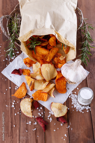 Healthy chips on paper with sea salt, rosemary and garlic