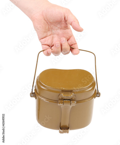 Hand holds military lunch box.