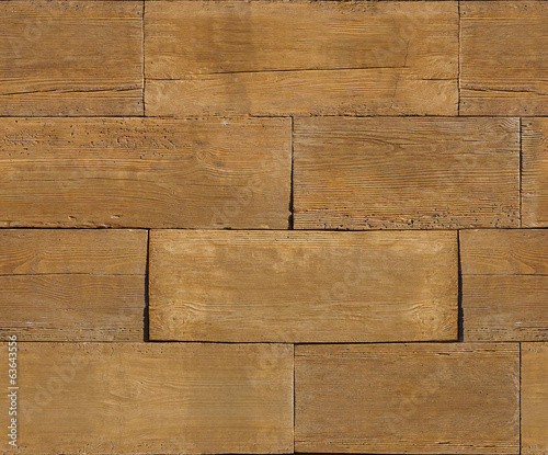 Natural wooden blocks stacked for seamless background