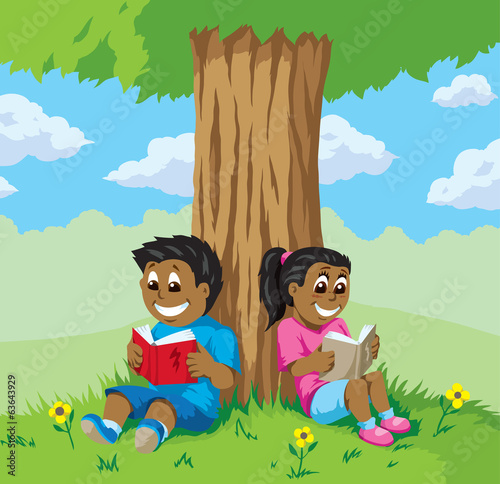 Cute kids reading under a tree