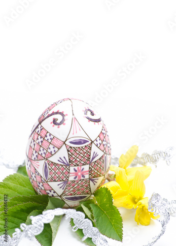 egg with ribbon and leaves