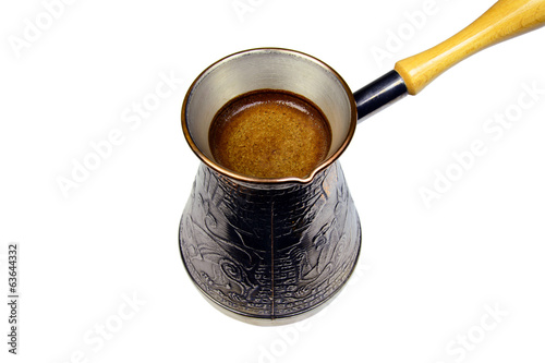 turkish coffee brewing pot isolated on white