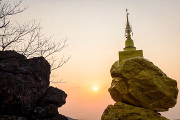 pagoda on rock stone and sunset time